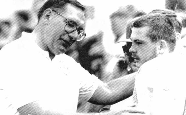Assistant Coach Roger Duncan talks with a player.