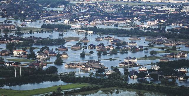 Floodwaters from Tropical Storm Harvey surround homes and businesses in Port Arthur, Texas, Thursday, Aug. 31, 2017.