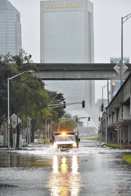 An Urban Flood Water Rescue Team with the Jacksonville Fire and Rescue Department makes its way along a flooded street on the Southbank of downtown as Hurricane Irma passes by Monday, Sept. 11, 2017 in Jacksonville, Fla.