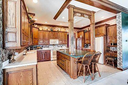 The kitchen area of the home at 3290 Stewart Road in Lima features custom oak trim and cabinetry by A & J Woodworking.