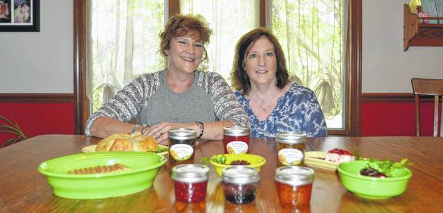 O'Sister Jams and Jellies owners Patti Bonifas, left, and Cindy Schwinnen started their small business five years ago out of their Delphos homes. Today, the sisters sell 34 kinds of jams and jellies at farmers' markets and craft shows throughout the region.