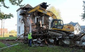 Out with the old; in with the new: Allen County Land Reutilization Corp. holds 100th Demolition
