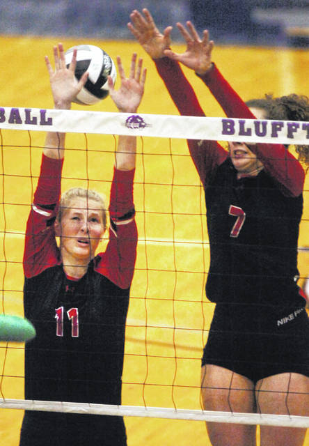 Shawnee's Amber Greeley (11) and Hailey Manuel go up for a block during Thursday night's Division II district final at Bluffton University.