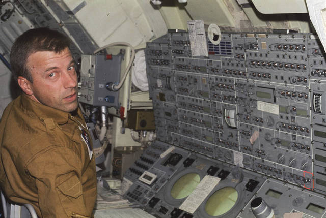 In this June 1973 photo, astronaut Paul J. Weitz, Skylab 2 pilot, mans the control and display console of the Apollo Telescope Mount. Weitz, who also commanded who commanded the first flight of the space shuttle Challenger and served as Deputy Director of Johnson Space Center, died Monday, Oct. 23, 2017, at his retirement home in Flagstaff, Ariz. He was 85.  (NASA via AP)