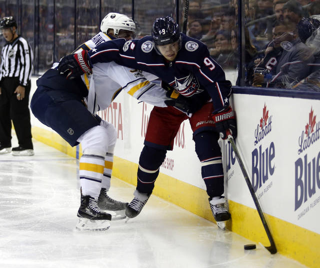 Columbus Blue Jackets forward Artemi Panarin, right, of Russia, works against Buffalo Sabres defenseman Rasmus Ristolainen, of Finland, during the second period of an NHL hockey game in Columbus, Ohio, Wednesday, Oct. 25, 2017. (AP Photo/Paul Vernon)