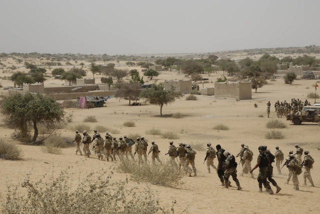 In this March 7, 2015, file photo, Chadian troops and Nigerian special forces participate in the Flintlock exercises with the U.S. military and its Western partners in Mao, Chad. The Pentagon told The Associated Press on Friday that there is no truth to claims in a viral story that Sgt. La David Johnson betrayed his fellow soldiers in an ambush that killed him and three of his comrades in Niger earlier this month.
