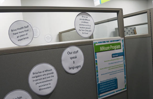 In this Oct. 26, 2017, photo, signs hang on enrollment cubicles at Briva Health in Minneapolis. Briva Health is MNsure's largest enrollment partner. Health care consumers in most of the country are encountering a world of confusion and chaos as the open enrollment period to sign up for coverage approaches. The outlook is decidedly different in the 12 states that operate their own marketplaces. California, Colorado, Minnesota and other states that operate autonomous exchanges are pulling out all the stops to inform consumers. (AP Photo/Jim Mone)