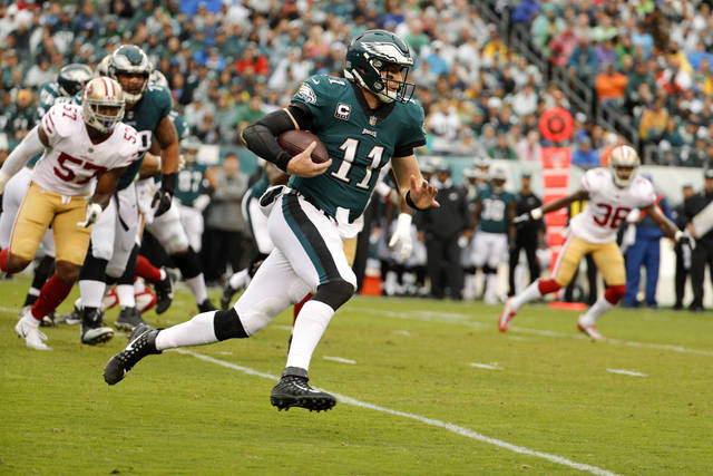 Philadelphia Eagles quarterback Carson Wentz (11) runs the ball during the first half of an NFL football game against the San Francisco 49ers, Sunday in Philadelphia.