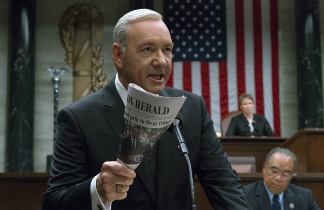 """This image released by Netflix shows Kevin Spacey in a scene from """"House Of Cards."""" Netflix says it's suspending production on the popular series following harassment allegations against Spacey."""