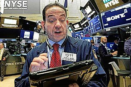 Trader Tommy Kalikas works on the floor of the New York Stock Exchange, Tuesday, Oct. 31, 2017. U.S. stock indexes held steady in early trading on Tuesday following strong earnings reports from the makers of Kellogg's cereals, Oreo cookies and others. (AP Photo/Richard Drew)