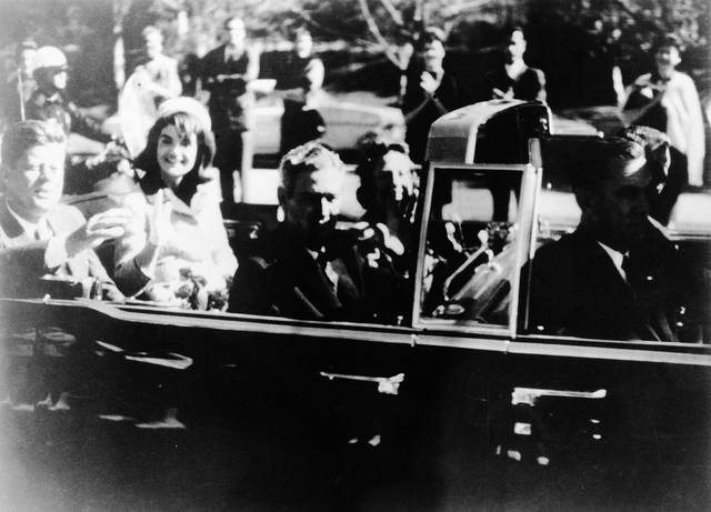 This image provided by the Warren commission, shows Warren Commission Exhibit No. 697, President John F. Kennedy at the extreme right on rear seat of his limousine during Dallas, motorcade on Nov. 22, 1963. His wife, Jacqueline, beside him, Gov. John Connally of Texas and his wife were on jump seats in front of the president. President Donald Trump is caught in a push-pull on new details of Kennedy's assassination, jammed between students of the killing who want every scrap of information and intelligence agencies that are said to be counseling restraint. How that plays out should be known on Oct. 26, 2017, when long-secret files are expected to be released.
