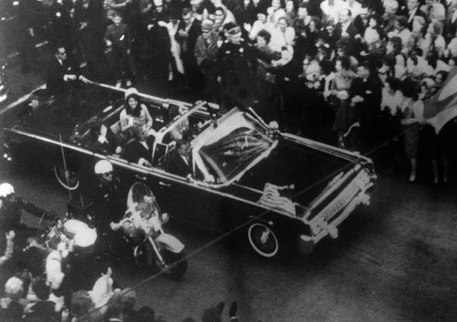This image provided by the Warren Commission is an overhead view of President John F. Kennedy's car in Dallas motorcade on Nov. 22, 1963, and was the commission's Exhibit No. 698. Special agent Clinton J. Hill is shown riding atop the rear of the limousine. President Donald Trump is caught in a push-pull on new details of Kennedy's assassination, jammed between students of the killing who want every scrap of information and intelligence agencies that are said to be counseling restraint. How that plays out should be known on Oct. 26, 2017, when long-secret files are expected to be released.