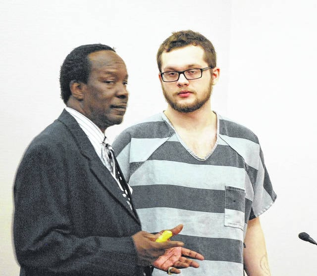 Anthony Spangler confers with his attorney, Jerry Pitts, prior to being sentenced to seven years in prison for aggravated robbery.
