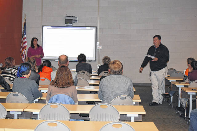 Elida High School Guidance Counselor Steve Smith addresses parents and students at Financial Aid Night.