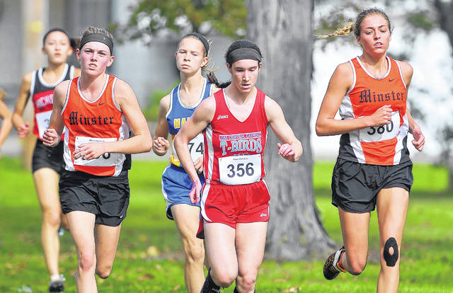 From left, Minster's Emma Watcke Marion Local's Kelsey Broering, Lima Central Catholic's Emily Sreenan, and Minster's Kaitlynn Albers compete during Saturday's district races at Ottawa Memorial Park. See more district photos at LimaScores.com.