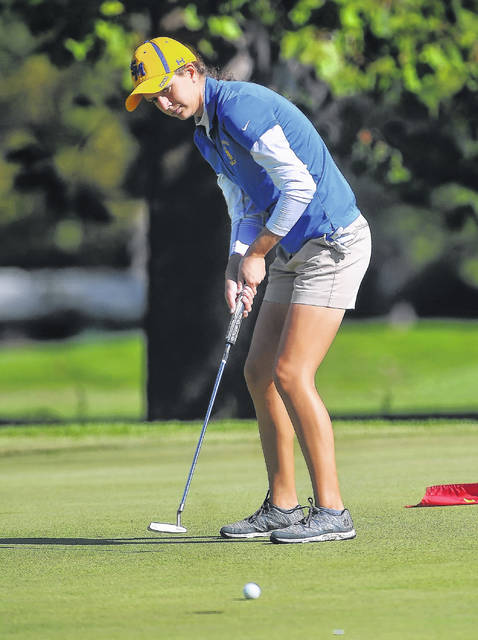 St Mary's Jill Schmitmeyer watches her putt on the ninth hole during Monday's district tournament at Sycamore Springs Golf Course in Findlay.  RICHARD PARRISH | The Lima News
