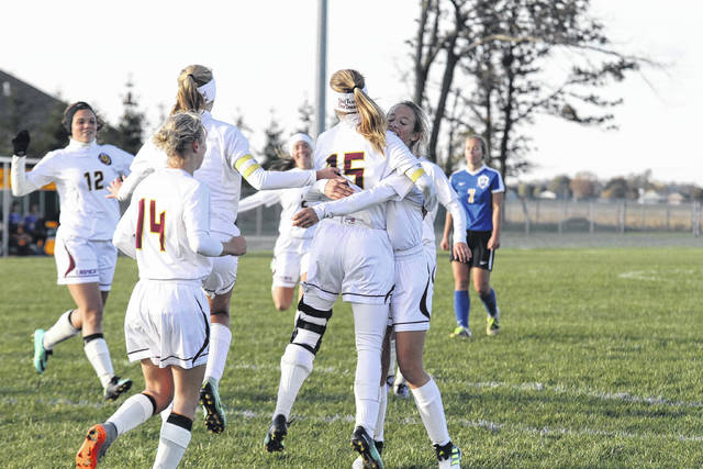 Kalida Ladycats celebrate after one of Hannah Warn's two goals during a Division III Wednesday night district semifinal against Continental at Ottoville. See more photos from the district semifinals at LimaScores.com