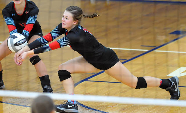 Lima Central Catholic's Kassidy Meyer makes a dig during Thursday night's Division IV district final at Ottawa-Glandorf High School.