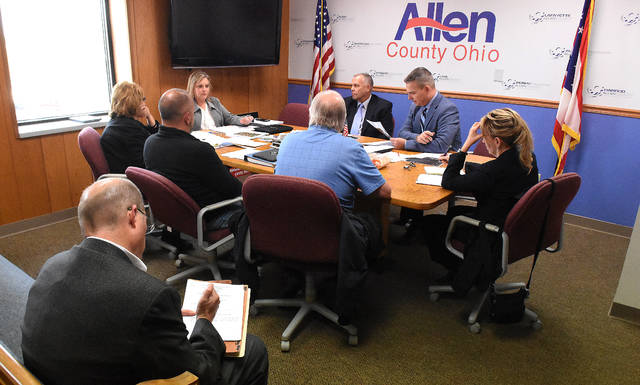 Allen County Land Bank members meet with Allen County Commissioners Jay Begg and Cory Noonan at the commissioners offices in downtown Lima on Thursday afternoon.