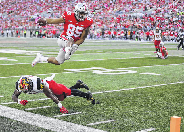 Ohio State's Marcus Baugh leaps over Maryland's Antoine Brooks, Jr. as he heads to the end zone for a touchdown during Saturday's game at Ohio Stadium in Columbus. See more game photos at LimaScores.com