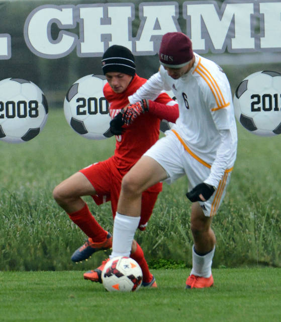 Kalida's Brad Siefker (1) plays the ball in front of Bluffton's Tayton Kleman during Saturday's Division III soccer district final in Kalida. See more match photos at LimaScores.com.