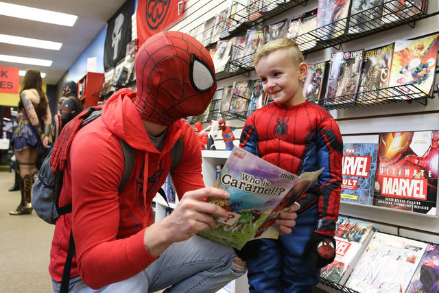 Chris Wayne and his 5-year-old son Carter dress as Spiderman and go comic book shopping during the Halloween Comicfest at Alter Ergo on Saturday afternoon.
