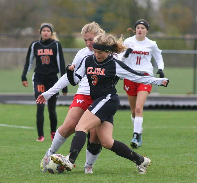 Elida's Cienna Kuhn steps in front of Wapakoneta's Katie Manger during Saturday's Division II district final at Elida.