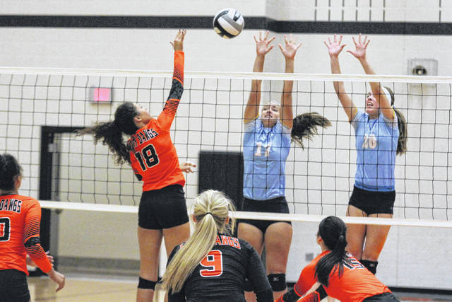 Elida's Cheyenne Welch goes up for a spike against Bath's Megan Truman, left, and Kaleigh Ketcham during Wednesday night match at Elida. See more match photos at LimaScores.com.