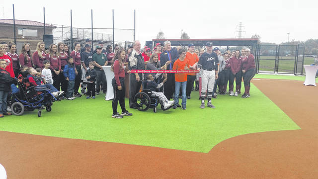 Members of UNOH's baseball and softball teams along with members of the Abilities Baseball League help cut the ribbon on the Rotary Field of Dreams at UNOH.