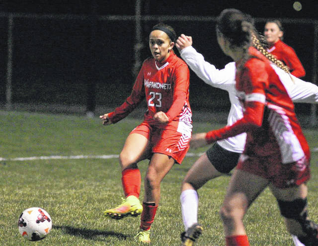 Wapakoneta's Madison Lause (23) fires a pass to a teammate during Tuesday night's Division II regional semifinals at Findlay High School.