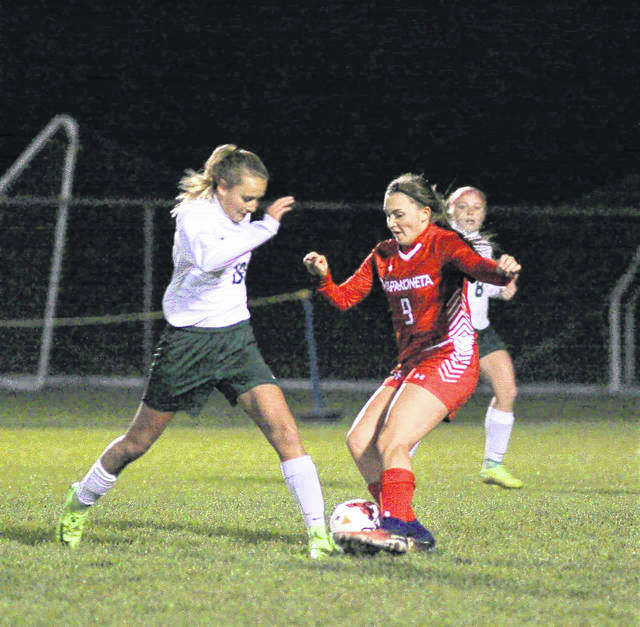 Wapakoneta's Emma Kentner battles Mansfield Madison's Phylllis Stanfield for the ball during the Division II regional semifinals at Findlay High School.