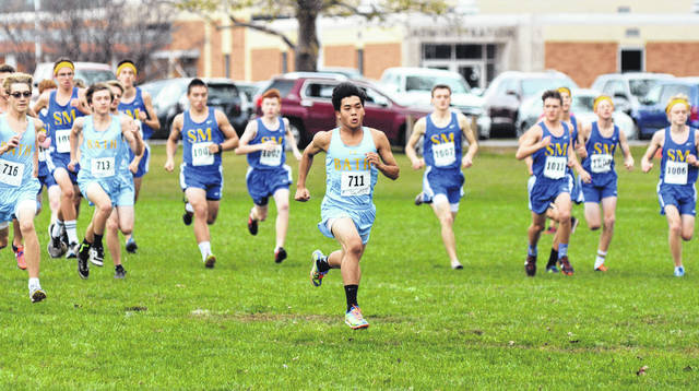 Bath's Jackson Chiem sprints for position at the start of the Western Buckeye League boys high school race Saturday at Bath High School.