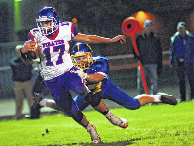 Riverside's Lucas Roby tries to shake free from Chase Martin of Delphos St. John's during Friday night's game at Stadium Park in Delphos.