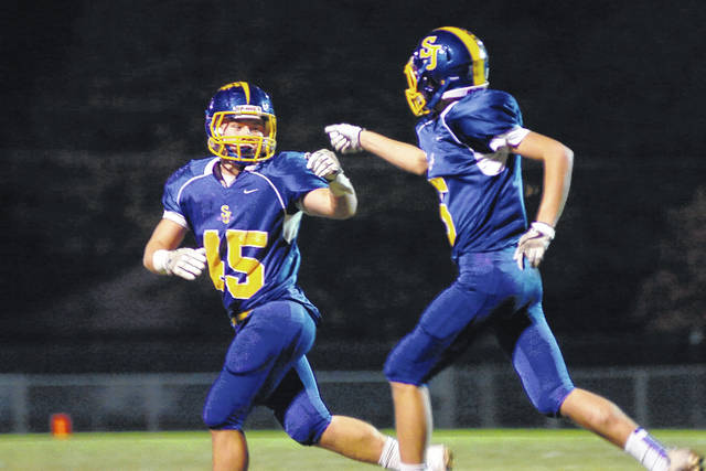 Delphos St. John's seniors Troy Schwinnen (45) and Connor Hulihan (5) were instrumental in the Blue Jays picking a first round playoff win over Riverside. The pair will be counted on to produce Friday night against Lehman Catholic.