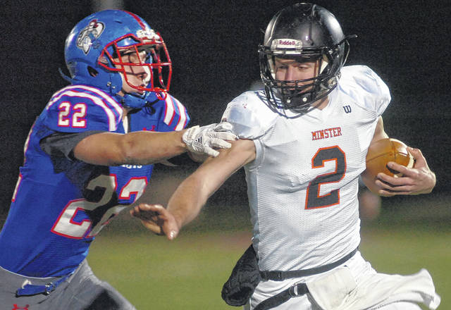 Minster's Jared Huelsman is chased by Crestview's Trevor Gibson during Friday night's game at Spartan Stadium.