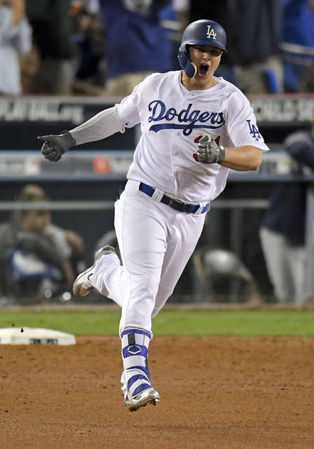 Los Angeles Dodgers' Joc Pederson celebrates his home run against the Houston Astros during the seventh inning of Game 6 of baseball's World Series Tuesday, Oct. 31, 2017, in Los Angeles. (AP Photo/Mark J. Terrill)