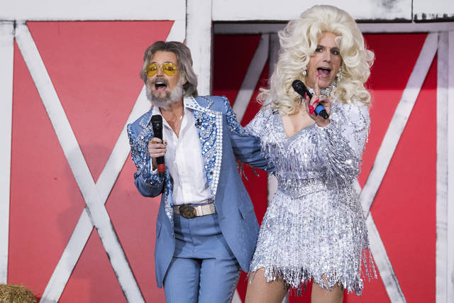 "Savannah Guthrie, left, and Matt Lauer dress as Kenny Rogers and Dolly Parton during NBC's ""Today"" show Halloween special at Rockefeller Plaza on Tuesday in New York."