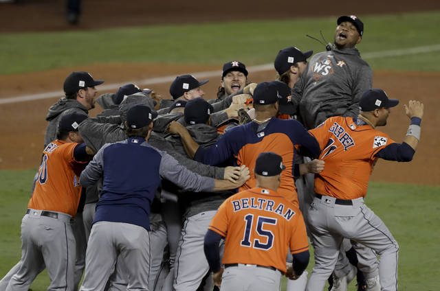 6659258fefa Members the the Houston Astros celebrate their win against the Los Angeles  Dodgers in Game 7