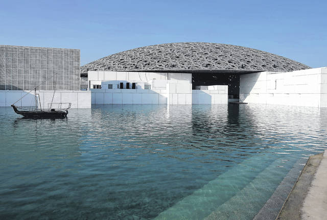 This Monday photo shows the Louvre Abu Dhabi in Abu Dhabi, United Arab Emirates. The Louvre Abu Dhabi is preparing its grand opening, unveiling its treasures to the world after a decade-long wait and questions over laborers' rights. The museum, which opens Saturday to the public, encompasses work from both the East and West.