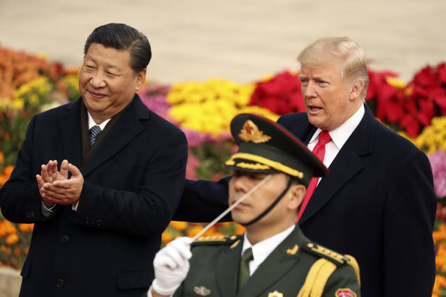 President Donald Trump and Chinese President Xi Jinping participate in a welcome ceremony at the Great Hall of the People, Thursday, Nov. 9, 2017, in Beijing, China. (AP Photo/Andrew Harnik)