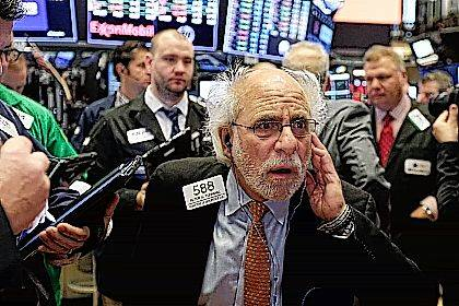 Trader Peter Tuchman works on the floor of the New York Stock Exchange, Thursday, Nov. 9, 2017. U.S. stocks are sinking Thursday morning as technology companies and most other parts of the market take sharp losses. (AP Photo/Richard Drew)