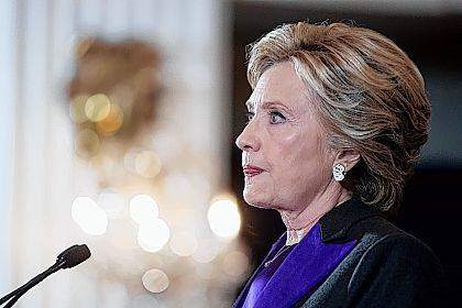 FILE - In this Nov. 9, 2016, file photo, Hillary Clinton pauses while delivering a speech conceding her defeat to Republican Donald Trump after the hard-fought presidential election. The AP reported on Nov.  10, 2017, that an article claiming Clinton didn't give a concession speech was false. (AP Photo/Andrew Harnik, File)
