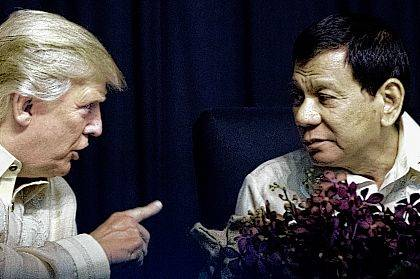 President Donald Trump speaks with Philippines President Rodrigo Duterte at an ASEAN Summit dinner at the SMX Convention Center on Sunday in Manila, Philippines.