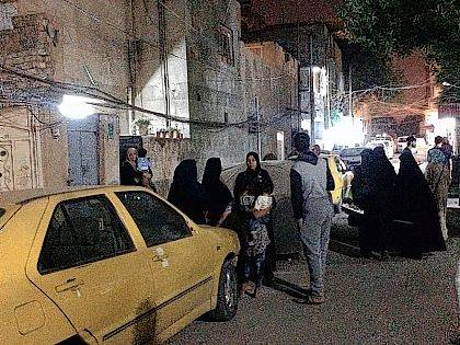People stand in the street after feeling aftershocks from an earthquake in Baghdad, Iraq, on Sunday. The deadly earthquake hit the region along the border between Iran and Iraq on Sunday. The U.S. Geological Survey said the quake was centered 19 miles (31 kilometers) outside the eastern Iraqi city of Halabja.