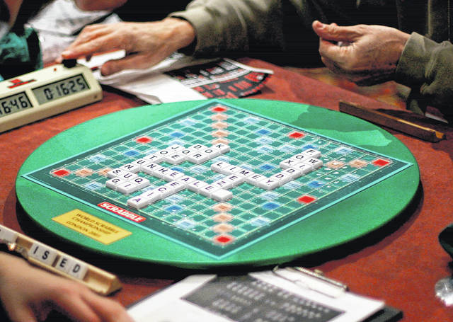 In this 2005 file photo, competitors take part in the World Scrabble Championships at a hotel in northwest London. The Association of British Scrabble players banned one of its star players, Allan Simmons, for three years after an independent investigation concluded he broke the rules of the popular game.