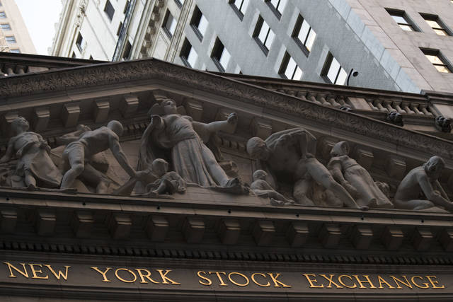 FILE - This Tuesday, Oct. 25, 2016, file photo shows the New York Stock Exchange at sunset, in lower Manhattan. Global stocks fell Monday, Nov. 13, 2017, as investors became more cautious after several market indexes hit record highs in the past week. (AP Photo/Mary Altaffer, File)