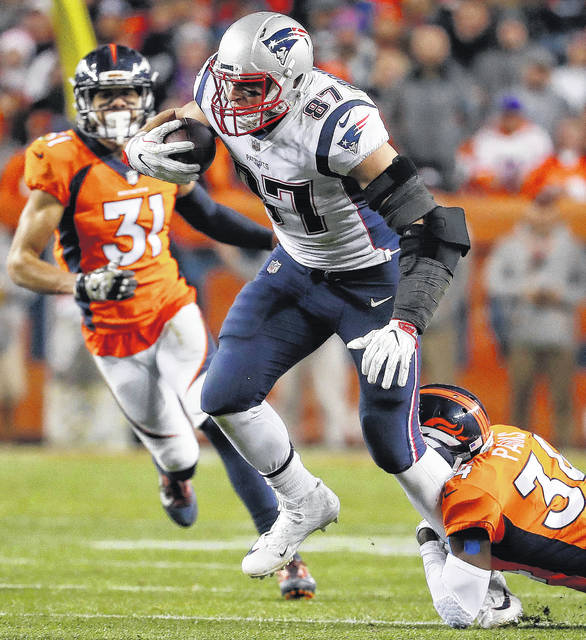 New England Patriots tight end Rob Gronkowski (87) is hit by Denver Broncos  strong