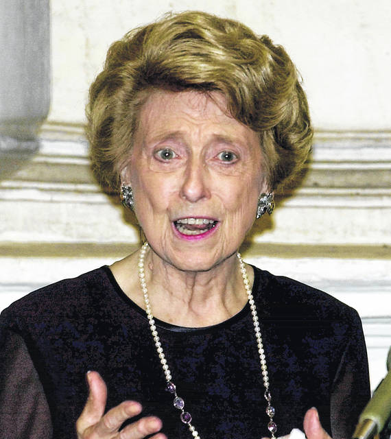 FILE - In this September 30, 2000, file photo, U.S. ambassador to the Holy See, Lindy Boggs, speaks during a news conference in Rome. They sponsor bills. They pass laws. They're some of the most powerful politicians in the United States. But they couldn't even wear pants to work until the mid-1990s. There may be more women in Congress than ever before, but Capitol Hill hasn't come close to achieving gender parity.