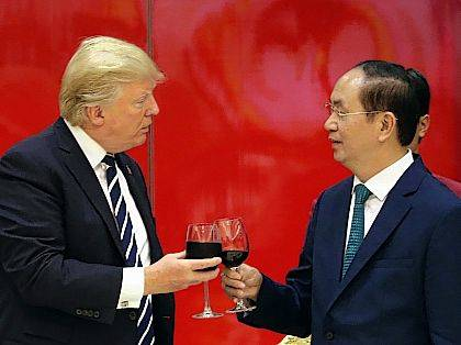 """President Donald Trump, left, and Vietnamese President Tran Dai Quang attend a State Dinner at the International Convention Center on Saturday in Hanoi, Vietnam. President Trump says the United States will no longer join large trade agreements, but instead will pursue one-on-one deals with nations that pledge allegiance to fair and reciprocal trade. Trump pulled the U.S. out of the 12-nation Trans-Pacific Partnership trade agreement. He says sweeping trade agreements """"tie our hands, surrender our sovereignty and make meaningful enforcement practically impossible."""""""
