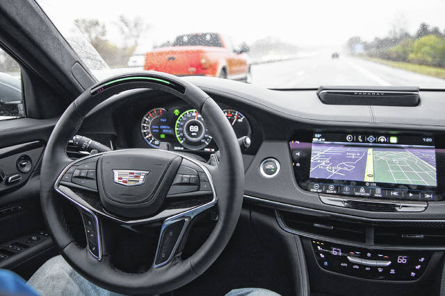 """Mark Phelan, auto critic for the Detroit Free Press, has the """"Super Cruise"""" engaged on the 2018 Cadillac CT6 on I-75 in on Nov. 2. Super Cruise works on restricted access highways in the U.S. and Canada. and it steers the car from the time you leave the entrance ramp until you're ready to exit the highway."""